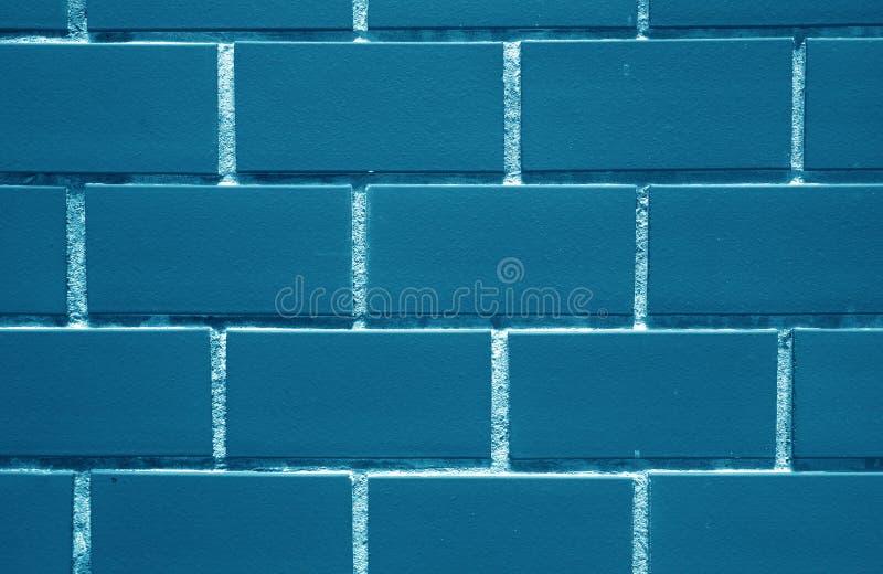 Индиго, стена кирпичей сини военно-морского флота покрашенная, для предпосылки, текстура стоковое фото rf