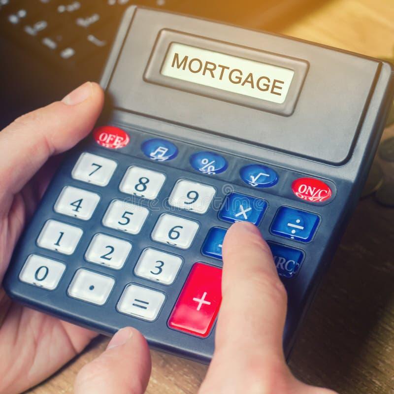 Ипотека надписи на калькуляторе Концепция высчитывать интерес на ссуде под недвижимость Ставки процента по закладной Покупающ дом стоковое изображение
