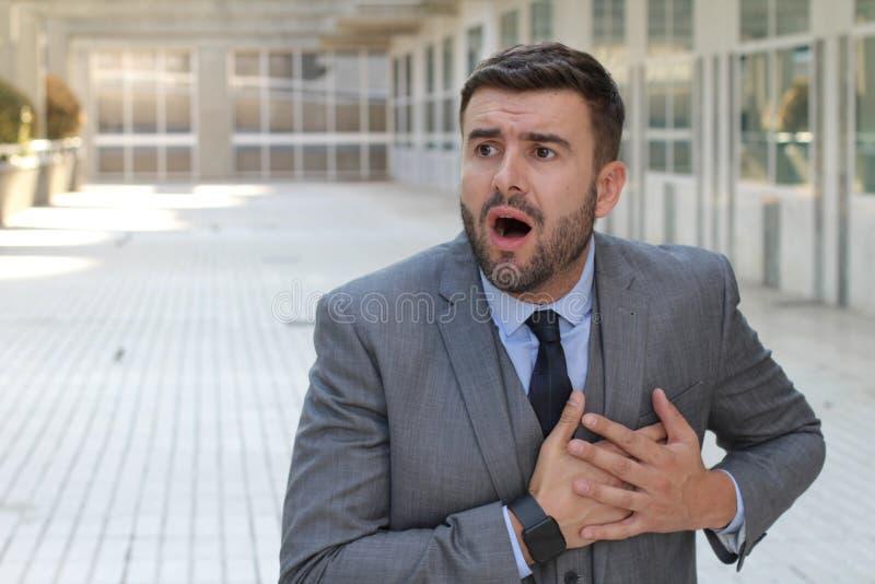 Ипохондричный бизнесмен потревожился о умирать стоковое фото