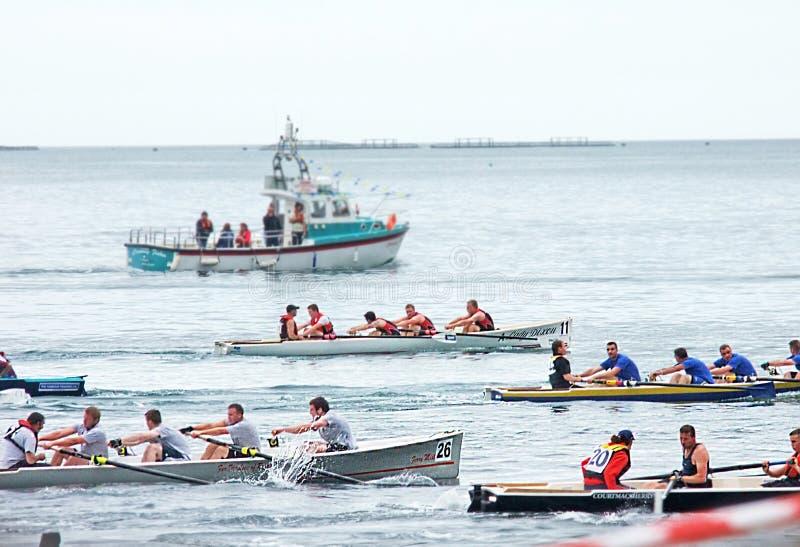 Ирландские прибрежные гребя чемпионаты Carnlough Co Антрим стоковые фотографии rf