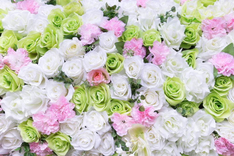 Искусственная красочная роза цветет предпосылка стоковые фото