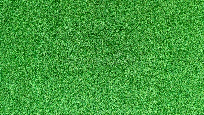 Искусственная текстура зеленой травы или предпосылка зеленой травы для поля для гольфа футбольное поле или предпосылка спорт стоковые изображения