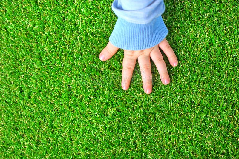 искусственная трава предпосылки E стоковые изображения rf