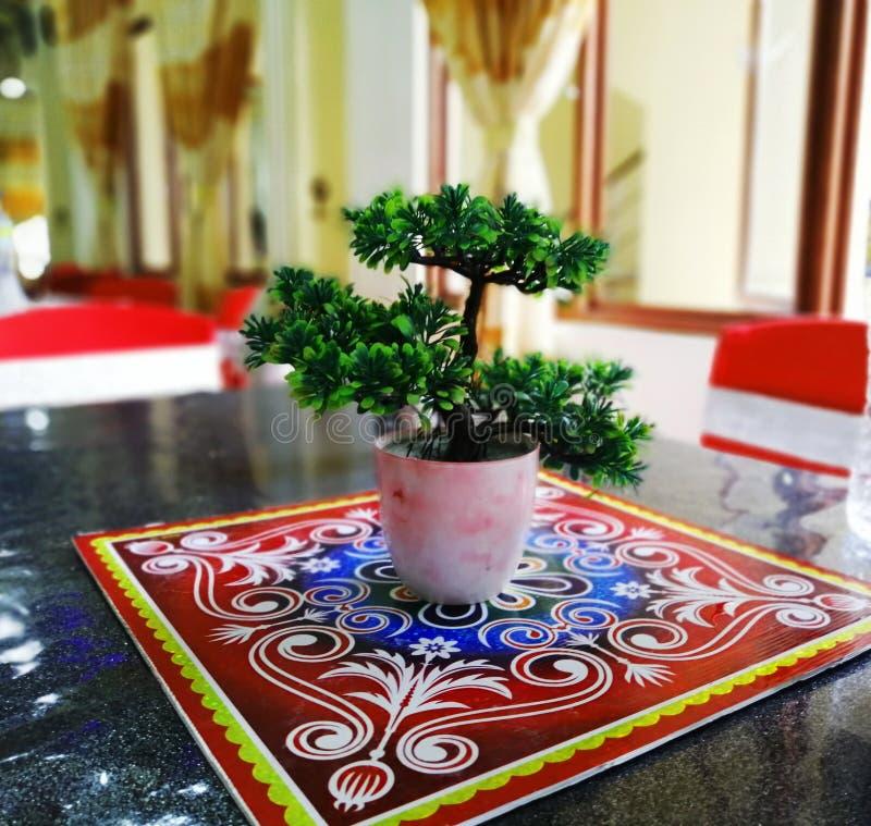 Искусственное небольшое зеленое растение стоковое фото rf
