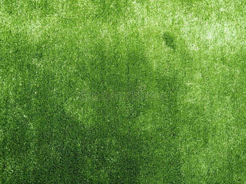 Искусственный пол зеленой травы стоковые фото