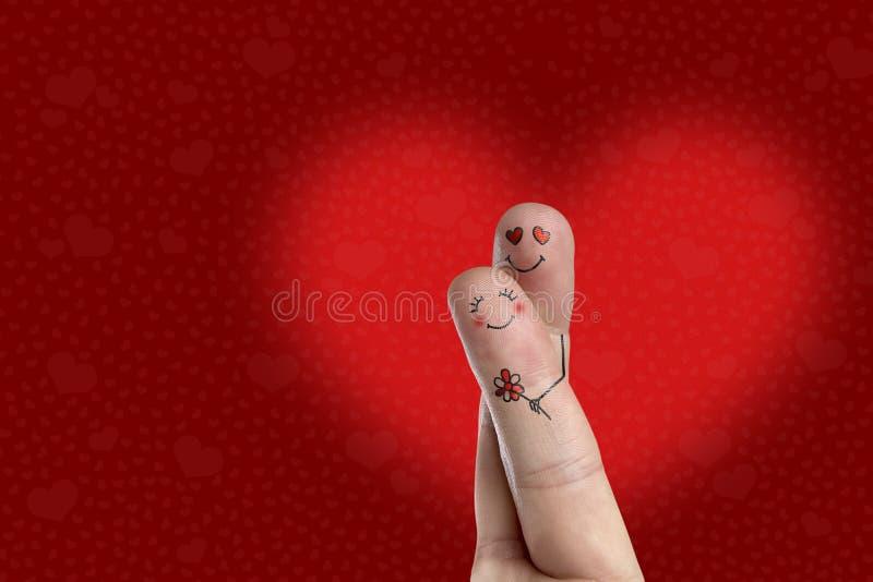 Искусство пальца счастливой пары Человек обнимающ и дающ цветок детеныши женщины штока портрета изображения стоковое изображение rf