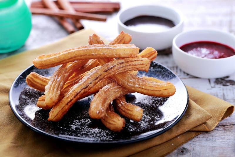 Испанские churros тап стоковое фото