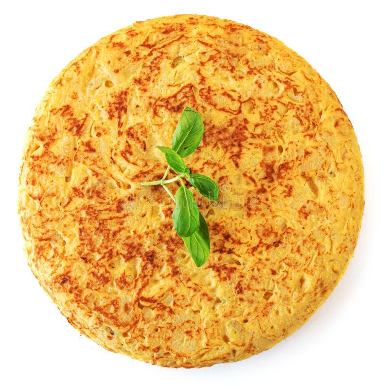 Испанский омлет изолированный на белой предпосылке Традиционное блюдо от испанской кухни с яйцами и картошкой - tortilla de patat стоковое фото