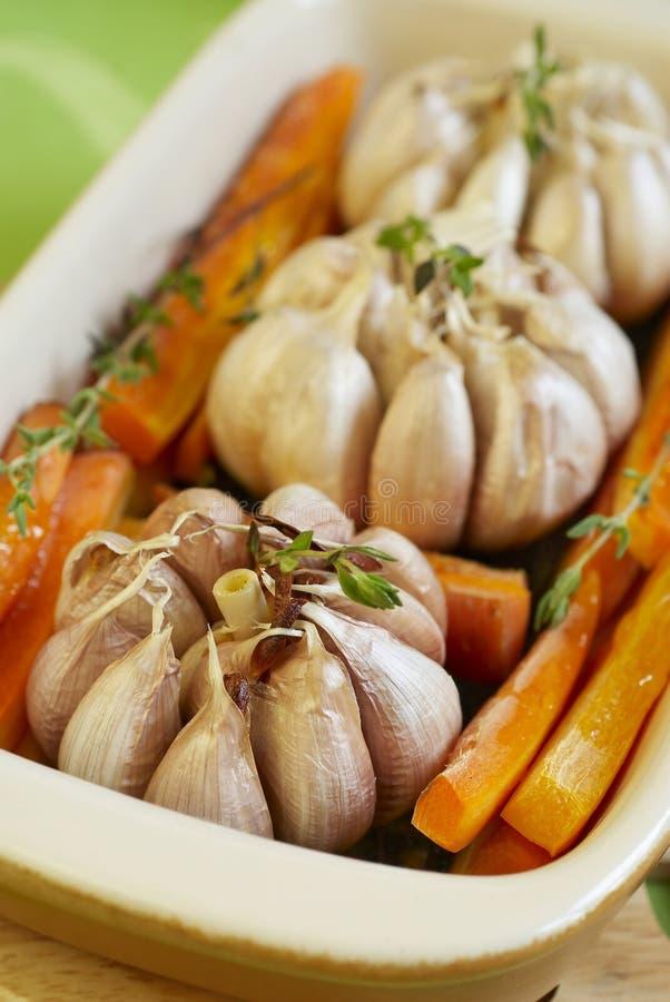 испеките чеснок морковей стоковое изображение
