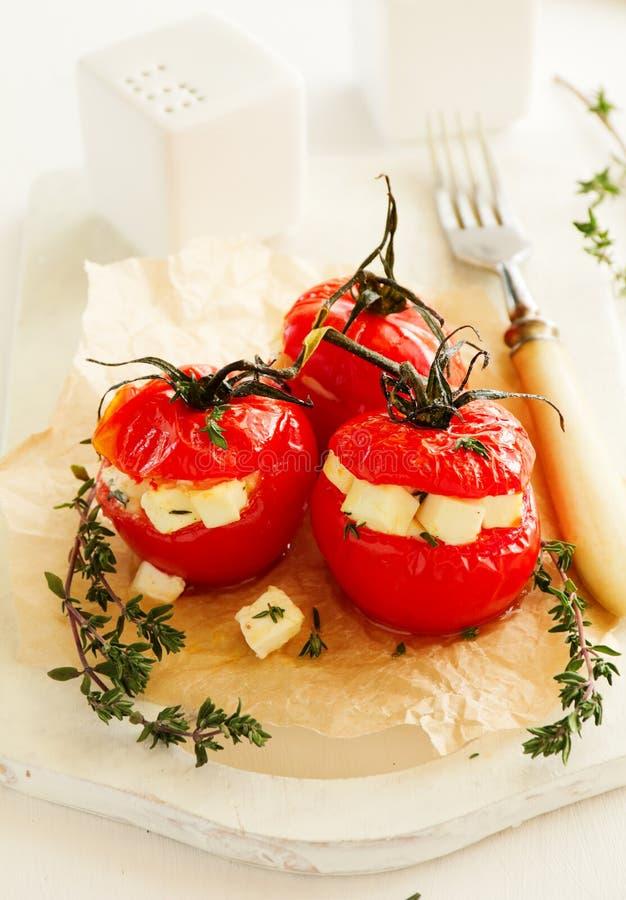 Испеченные томаты заполненные с сыром стоковое изображение rf