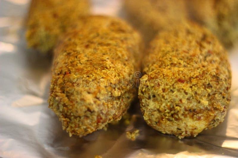 Испеченный цыпленок с семенем сезама стоковое фото