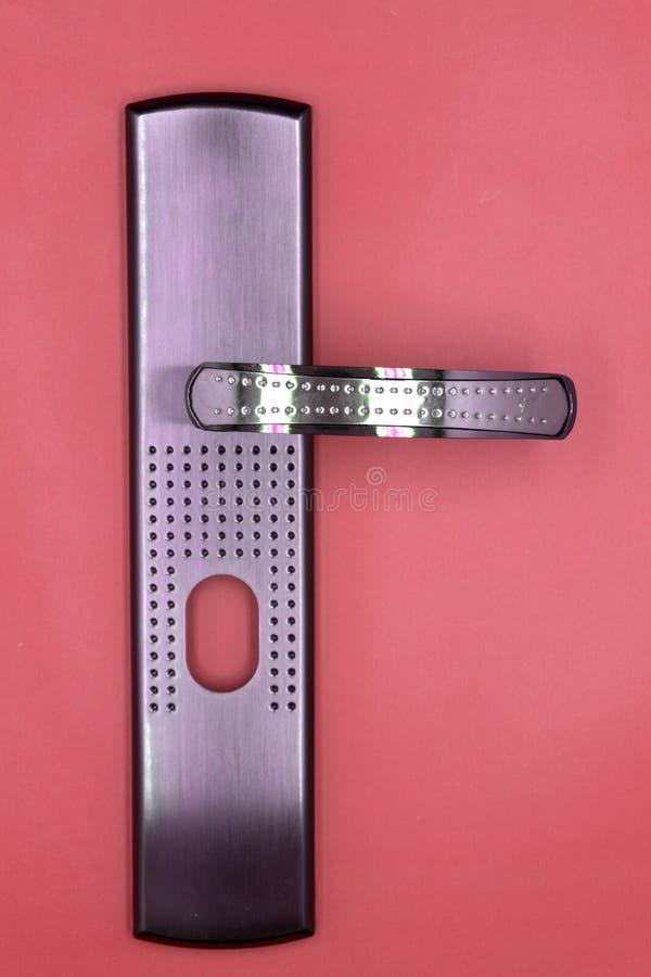 Используемая рука пальца элемента золота замка ручки двери стоковая фотография rf