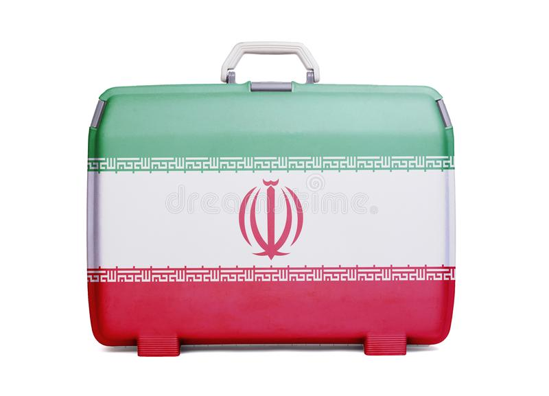 Используемый пластичный чемодан с пятнами и царапинами стоковое изображение