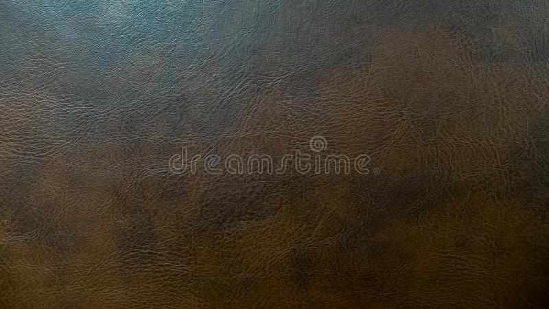 Используемая темная текстура предпосылки картины Брайна кожаная безшовная для материала мебели стоковая фотография
