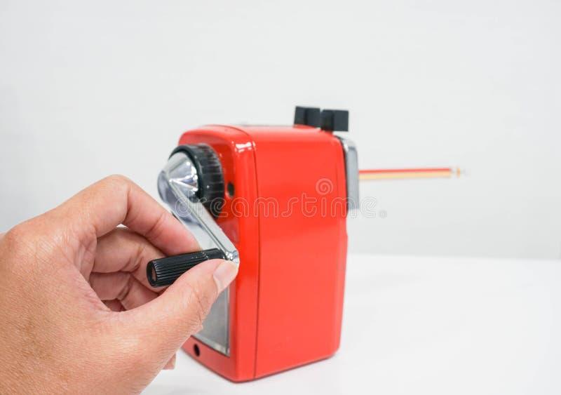 Используйте красную точилку для карандашей стоковое фото rf