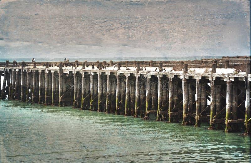Исторический причал Sumpter, Oamaru Изображение текстурированное Grunge стоковое изображение