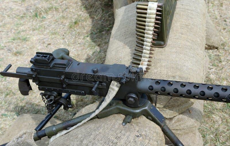 Исторический пулемет с пулями над мешками с песком в wa канавы стоковое фото