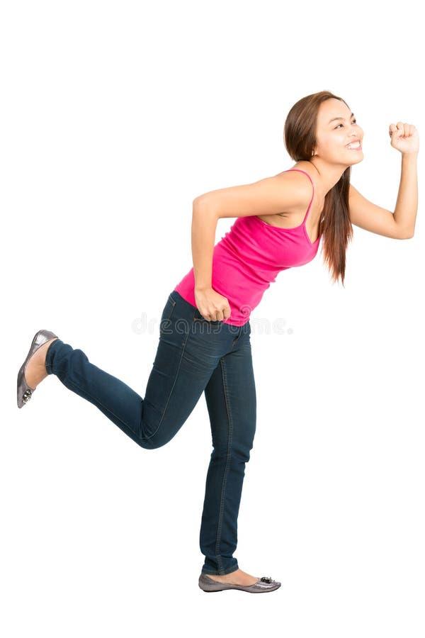 Идущая азиатская женщина гоня профиль объекта бортовой стоковое фото rf