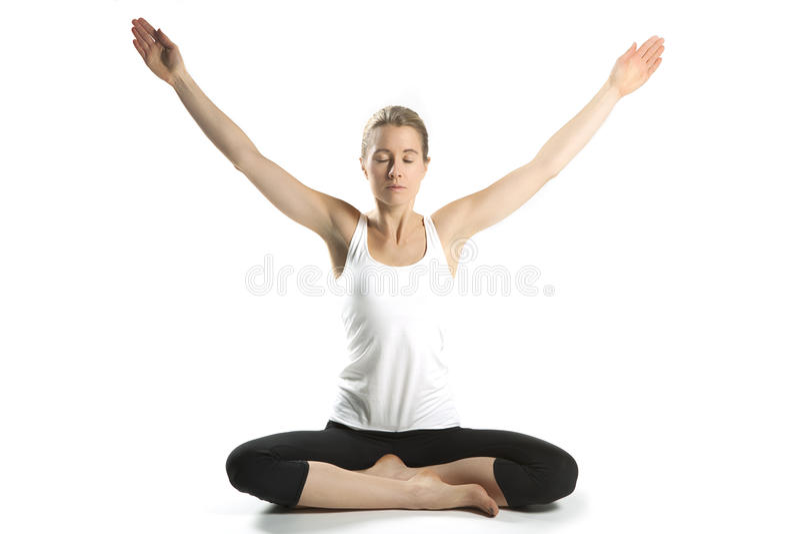 Йога практики женщины  стоковая фотография rf