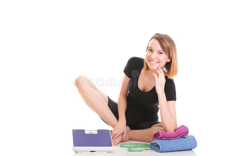 Download Кавказским белизна веса молодой женщины изолированная масштабом Стоковое Фото - изображение насчитывающей ободрение, горизонтально: 33734408