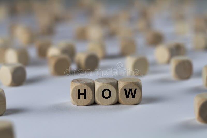 Как - куб с письмами, подписывает с деревянными кубами стоковые изображения