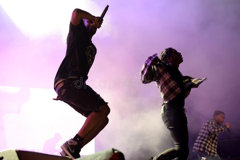 КАК МОЖНО СКОРЕЕ скалистый рэппер от Гарлема и член тазобедренного коллектива хмеля КАК МОЖНО СКОРЕЕ толпятся в концерте на фести стоковые изображения rf