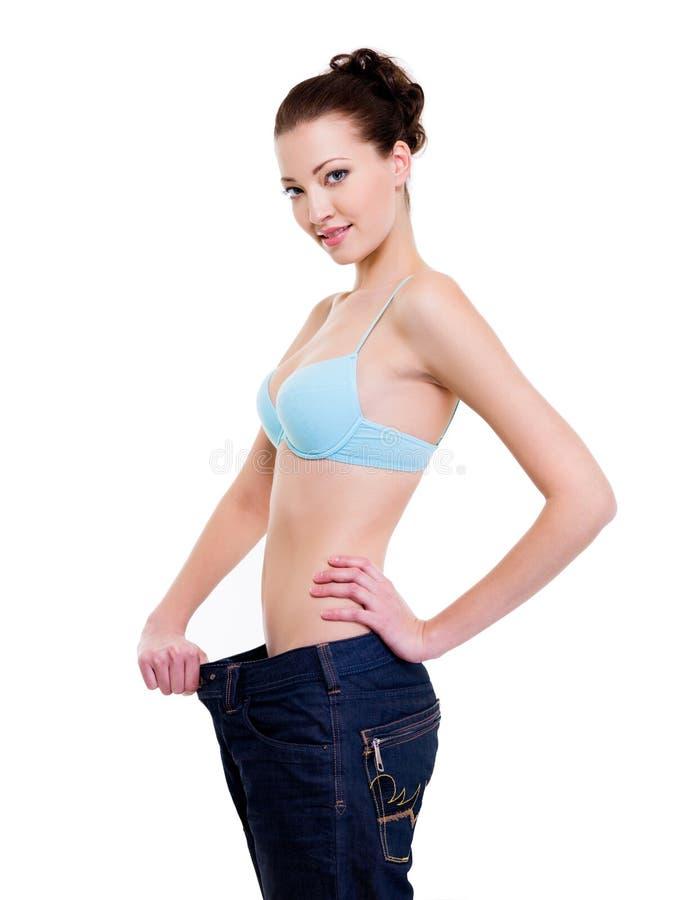 как потеряно много показывая женщине веса стоковое изображение
