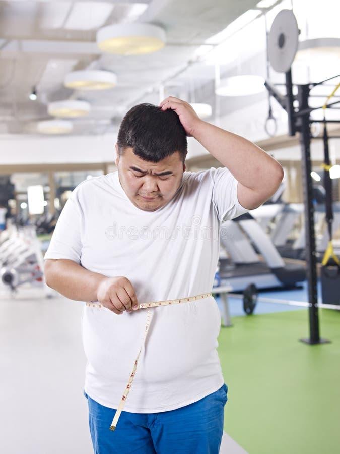 Как я идя потерять этот вес! стоковые фотографии rf