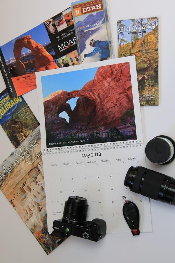 Календарь перемещения с брошюрами Юты & Колорадо стоковые изображения