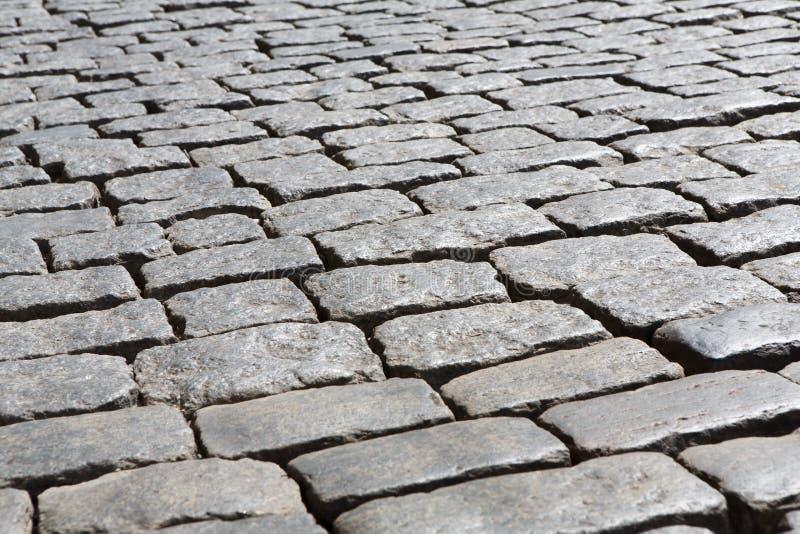 Каменная вымощая текстура Абстрактная старая предпосылка мостоваой стоковое фото