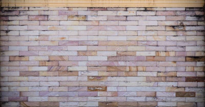 Каменная кирпичная стена, стена grunge стоковое фото