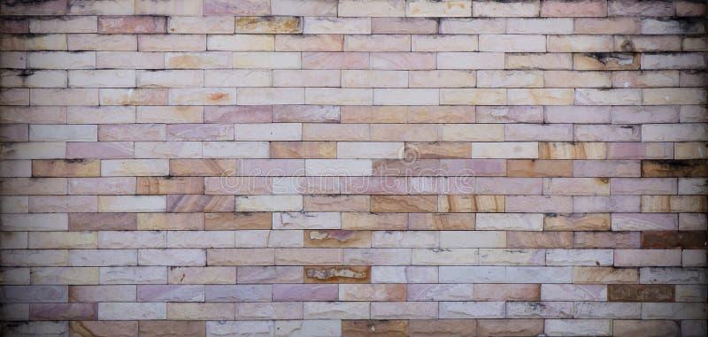 Каменная кирпичная стена стоковые фотографии rf