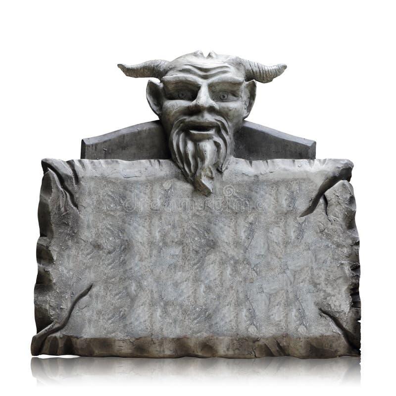 Каменная доска знака с головой дьявола, космосом экземпляра и путем клиппирования стоковые изображения rf