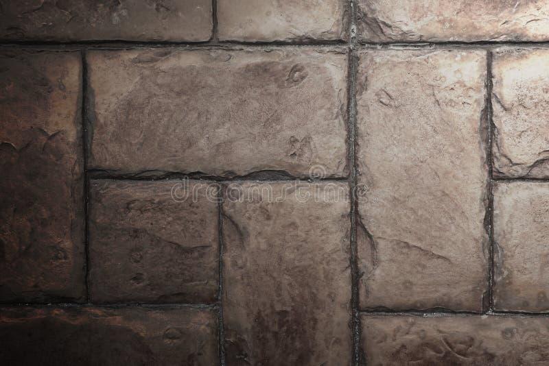Каменная текстура предпосылки кирпичной стены цемента плитки с освещать fr стоковые изображения