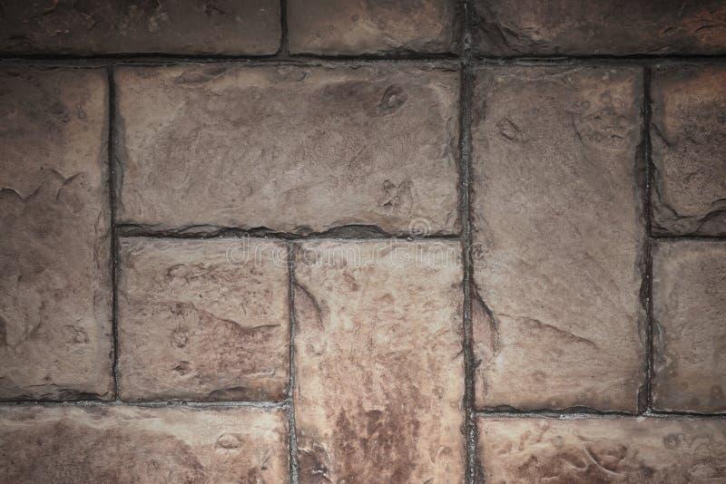 Каменная текстура предпосылки кирпичной стены цемента плитки с освещать fr стоковая фотография rf
