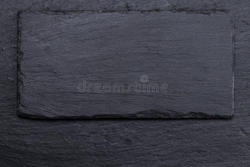 Каменная черная текстура предпосылки шифера, роскошный пробел для дизайна стоковое изображение rf