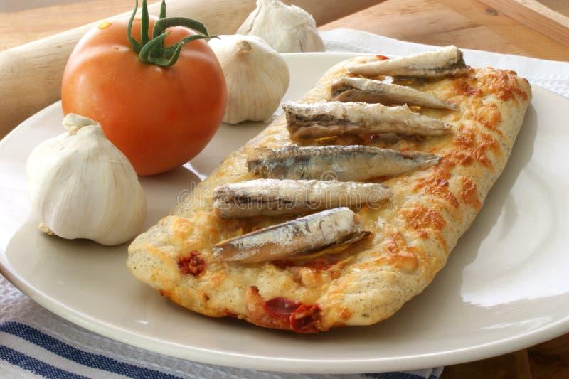 Каменной пицца испеченная печью стоковое фото