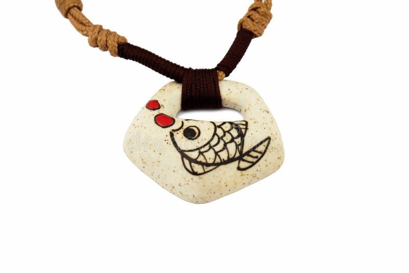 Каменные рыбы ожерелья стоковая фотография
