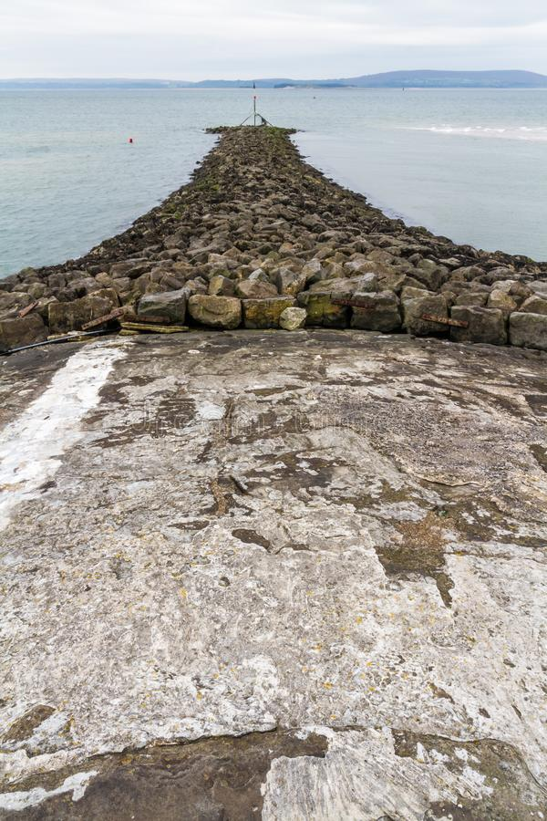 Каменный волнорез стоковая фотография rf