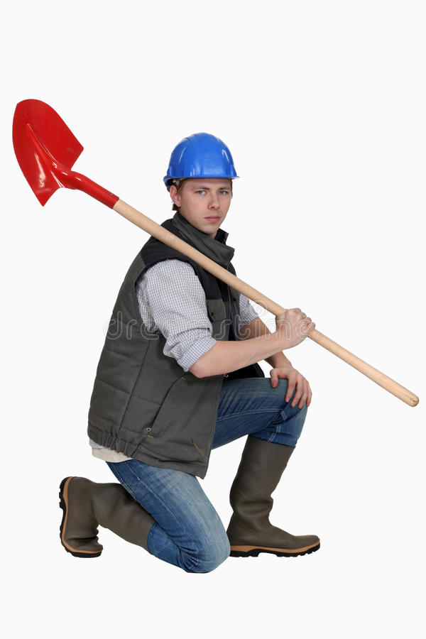 Каменщик держа лопаткоулавливатель стоковые изображения rf