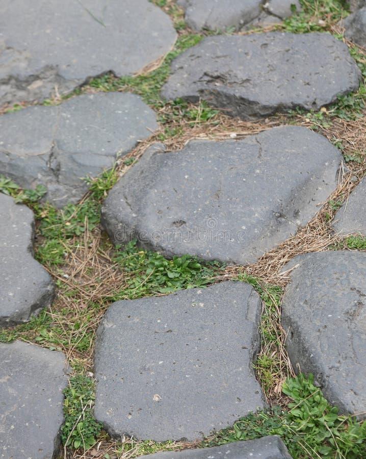 камень старой римской дороги в Риме Италии стоковая фотография