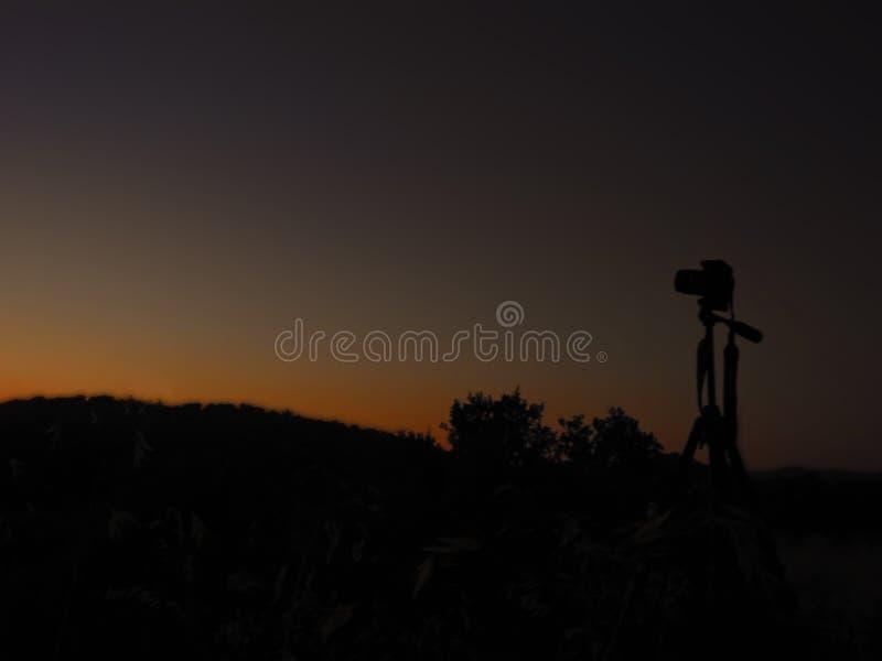 Камера и заход солнца стоковые изображения