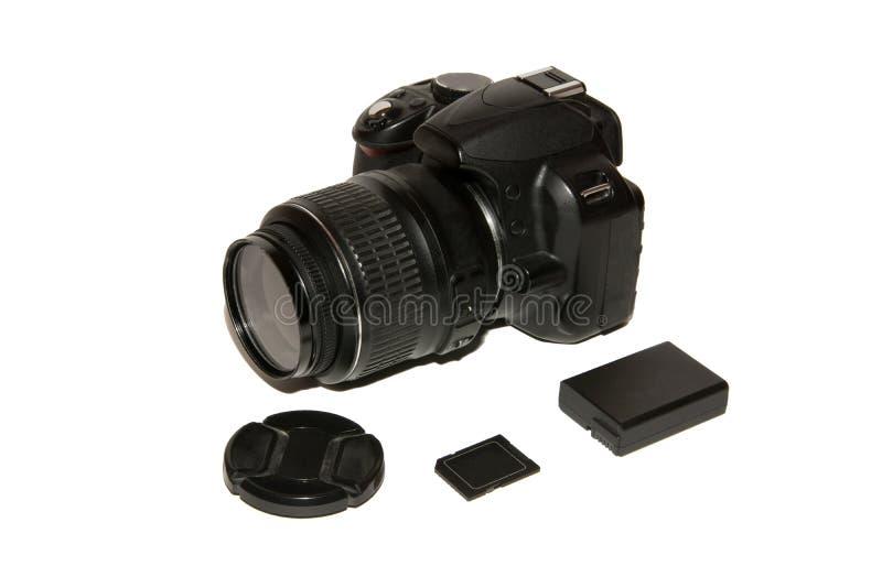Камера SLR с дополнительными батареей и картой памяти Редакционная иллюстрация стоковые фото