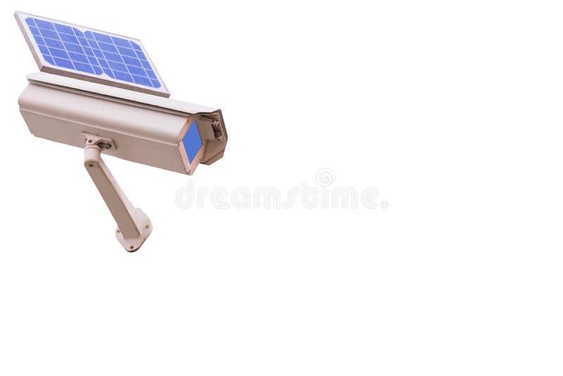 Камеры CCTV безопасностью при изолированная панель солнечных батарей стоковые изображения