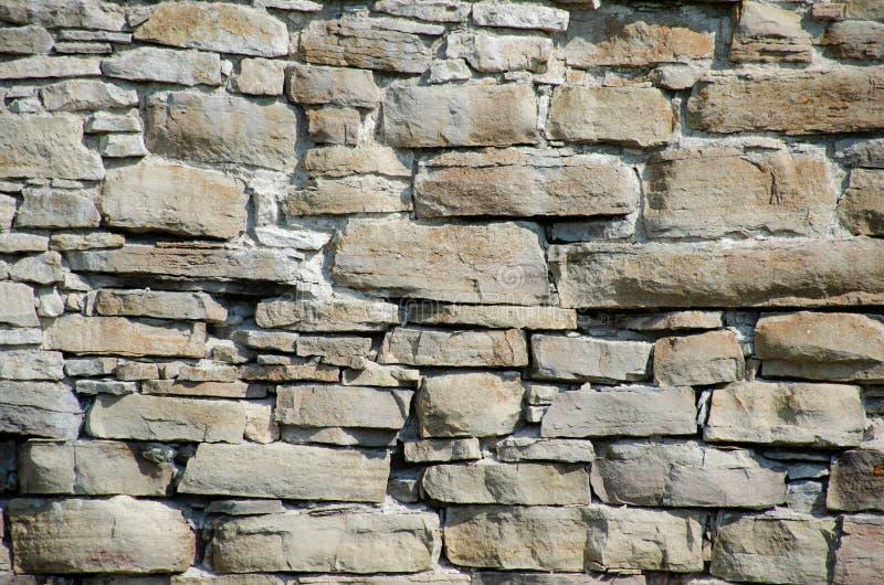 Камни и кирпичи старого средневекового замка Текстура стены стоковое фото rf