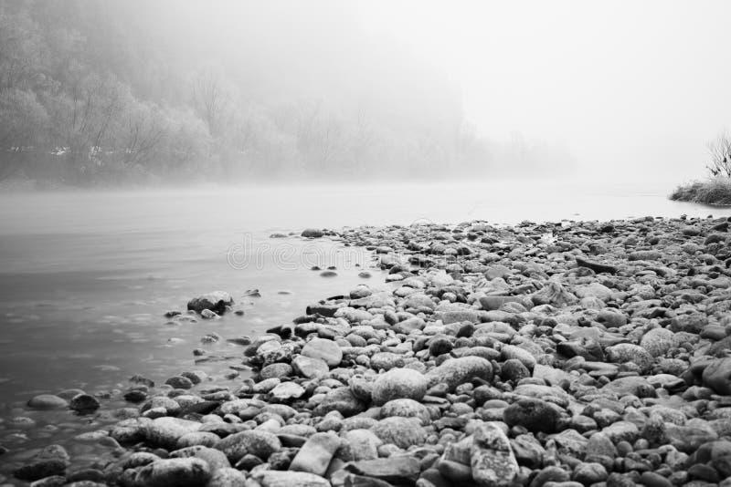 Камни на реке стоковые изображения