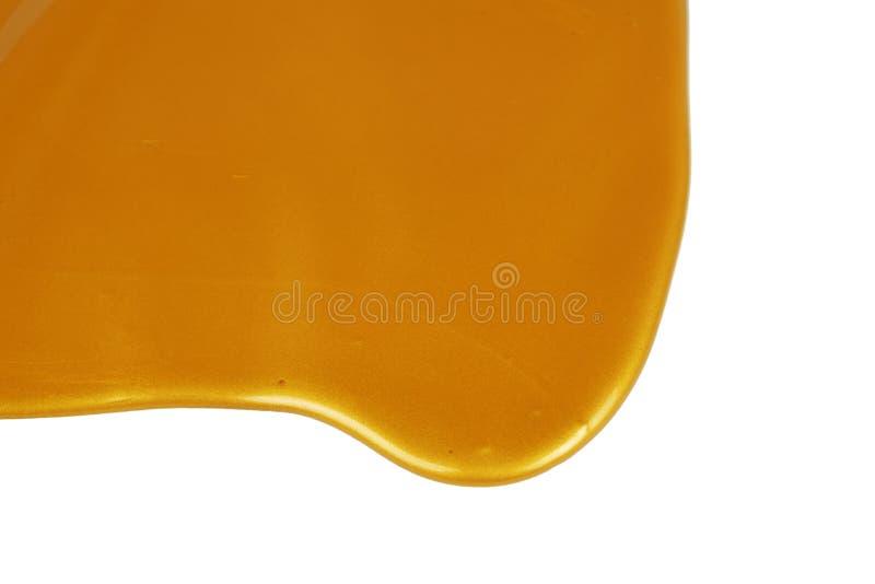 Капая золотая краска стоковая фотография rf