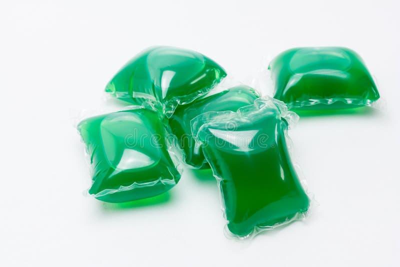 Капсулы с тензидом liquit прачечной стоковая фотография rf