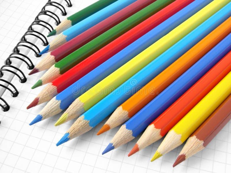 карандаши блокнота стоковая фотография