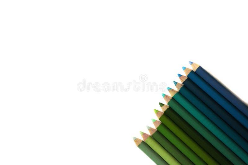 Карандаши на листе бумаги стоковые фотографии rf